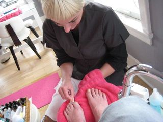 Erika gives a pedicure